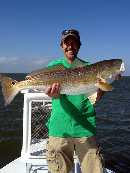"Scott with his 33"" redfish 2011"